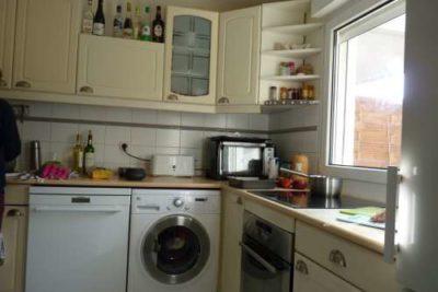 1 L'appartement Une cuisine toute équipée lave linge lave vaisselle four et plaque moderne de cuisson un agréable séjour plein ouest